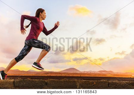 Athlete trail running silhouette of a woman runner at sunset sunrise. Cardio fitness training of marathon race sportswoman. Active healthy lifestyle in summer nature outdoors. poster