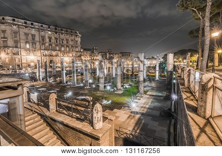 Italy, Rome, Piazza Foro Traiano - Ruins of Trajan's Forum along Via dei Fori Imperiali shooted in the night.