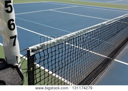 Tennis court sideline on a sunny day