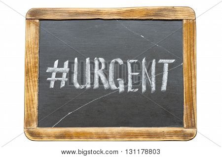 urgent hashtag handwritten on vintage school slate board isolated on white poster