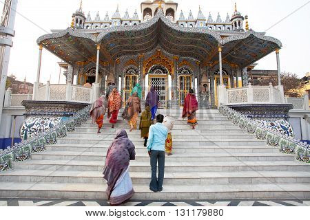 KOLKATA, INDIA - JAN 12, 2013: Believers Jains come in fantastic Sheetalnathji Jain temple at evening on January 12, 2013 in West Bengal, India. Temple founded in 1867 and erected in 1910.