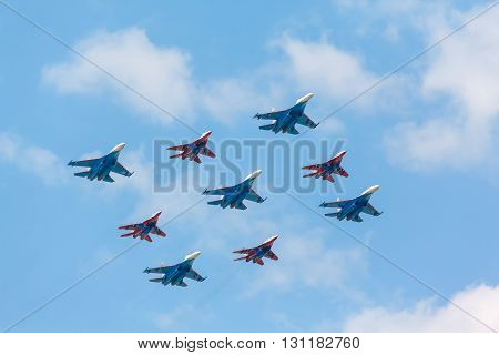 MOSCOW, RUSSIA - MAY 9, 2016: Su-27 and Mig-29 fighter aircraft piloted by members of the Russian Knights and Swifts aerobatic teams perform Kubinka Diamond at the rehearsal of the Victory Day parade.