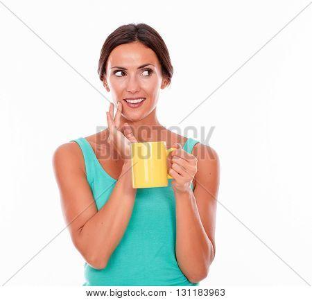 Thinking Brunette Woman With Coffee Mug