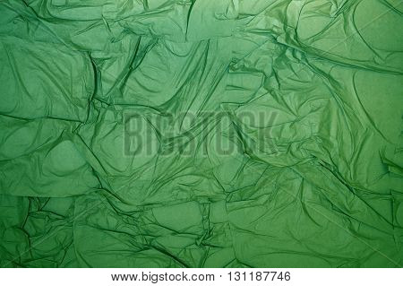background of crumpled wrapping paper. green wrinkled wrapping paper