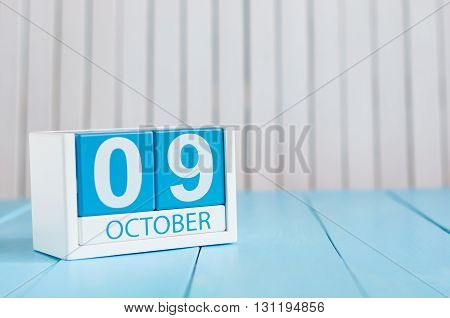 October 9th. Image of October 9 wooden color calendar on white background. Autumn day. Empty space for text.