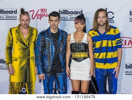 LAS VEGAS - MAY 22 : (L-R) recording artists Cole Whittle Joe Jonas JinJoo Lee and Jack Lawless of DNCE poses in the press room at the 2016 Billboard Music Award on May 22 2016 in Las Vegas