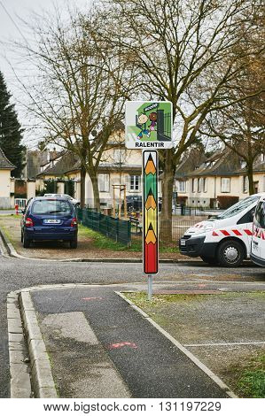 STRASBOURG FRANCE - FEBRUARY 4 2016: Slow down Ralentir street sign near in school in the french city street