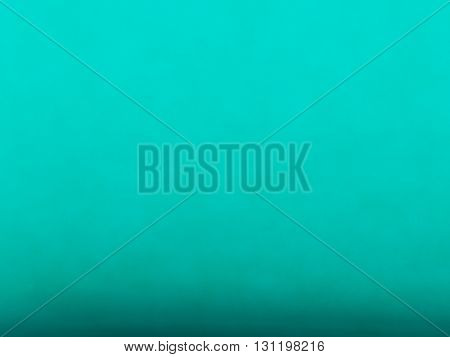 Dirty turquoise grunge background. Digitally generated soft grunge texture with subtle noise and dark bottom.