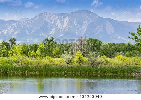 View of Flatirons in Boulder, Colorado from Walden Pond