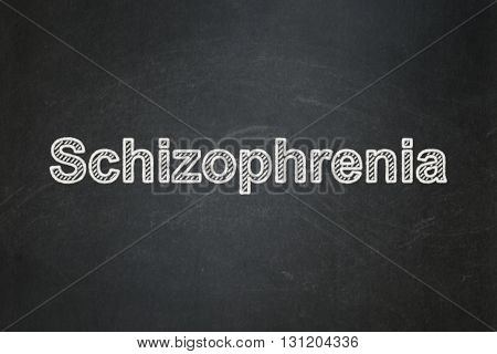 Healthcare concept: text Schizophrenia on Black chalkboard background