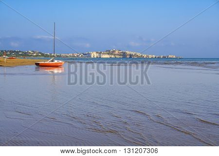 Gargano coast: low tide.Portonuovo beach: Vieste (Apulia)- ITALY-Portonuovo beach is a succession of fine sand dunes,crossed by many little kars streams,that cool the visitors in the hot summer time.