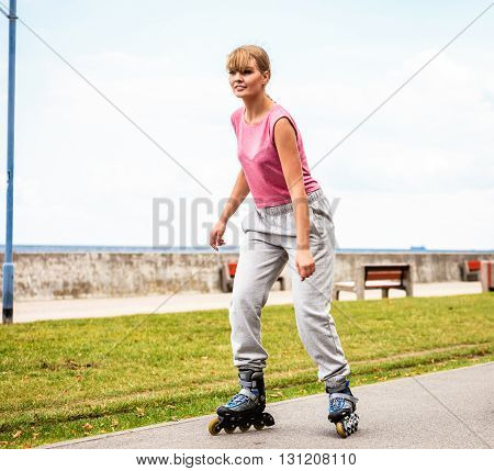 Active Young Woman Rollerskating Outdoor.