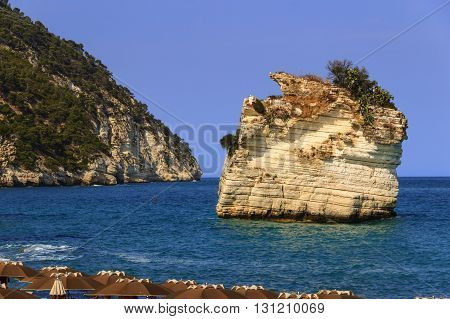 The most beautiful coasts of Italy:Baia dei Mergoli beach (Apulia),The beaches offer a breathtaking view with brigthly white karstic cliffs,emerald-blue sea,lush greenery of olive-trees, ,pine-woods.