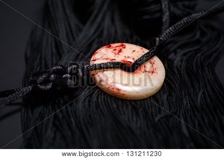 tassel of Tai Chi sword on the black background closeup