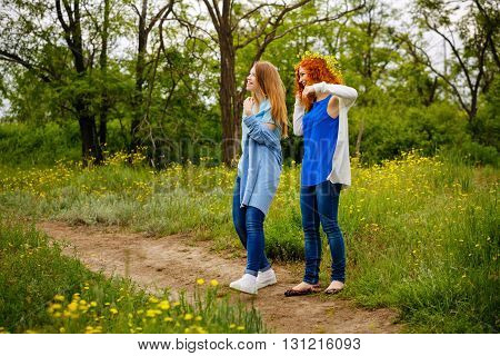 Best friends forever. Girlfriends spend time together in the park. BFF. Close friends. Gentle friendship.