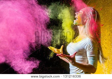 Portrait of a beautiful female with holi paint