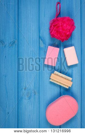 Cosmetics and accessories for personal hygiene in bathroom soap sponge bath puff brush pumice concept of body care copy space for text