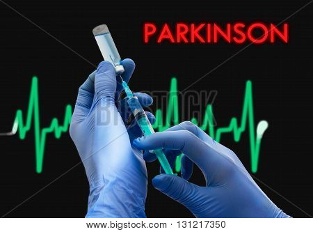 Treatment of parkinson. Syringe is filled with injection. Syringe and vaccine. Medical concept.