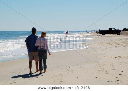 Couple Enjoying A Beach Walk