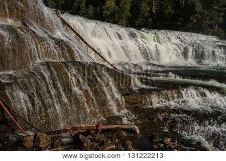 Boy at Dawson falls in near Clearwater British Columbia Canada