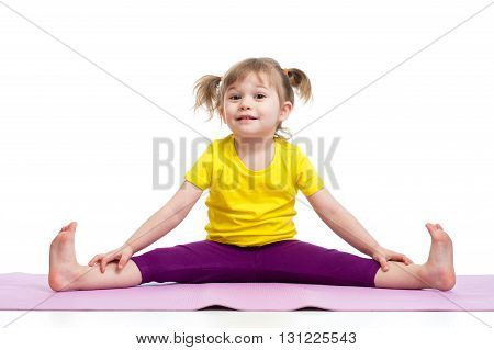 Kid girl doing fitness exercises on gymnastic mat