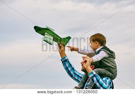 happy father with son playing with toy plane. dream to be a pilot