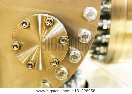 Flanged vacuum equipment. Shiny metal surface. A metal surface treated.