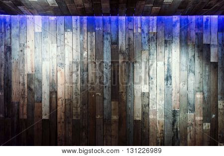 Wood wall with spot lights for background.