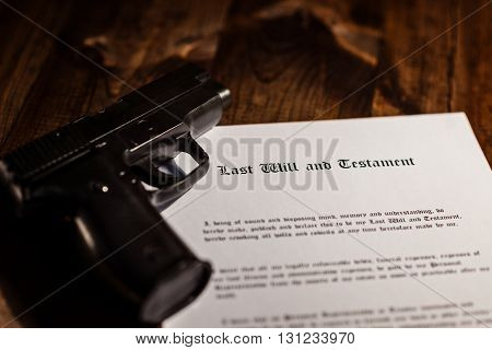 Pistol And Testament On Desk