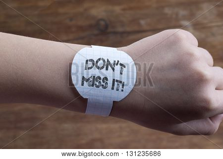hand with handmade paper watches and don't miss it exclamation print