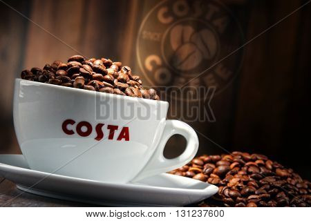 Composition With Cup Of Costa Coffee Coffee And Beans