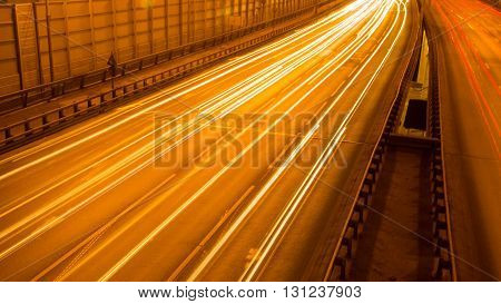 A long exposure shot of night city traffic on a highway