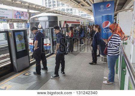 BANGKOKTHAILAND - APR 29 : massive of Unidentified people wait for train upcoming on platform at BTS Bangchak station on april 29 2016 Thailand.