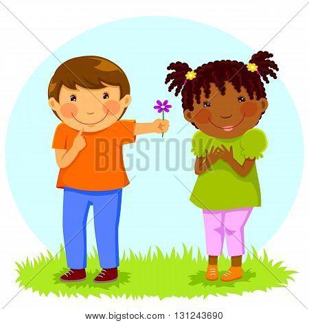 Caucasian boy gives a flower to an African girl