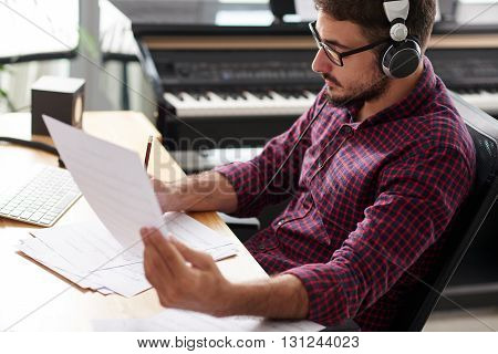 Portrait of professional songwriter working in studio