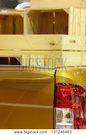 Pick-up boot detail with wooden box delivery. Vertical format