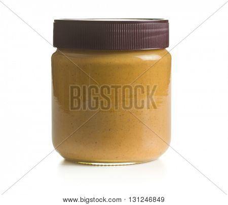 Creamy peanut butter isolated on white background. Spreads peanut butter in the jar.