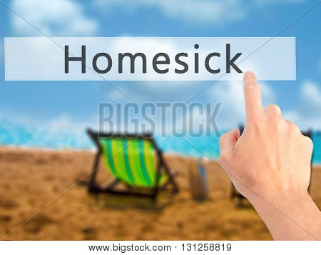 Homesick - Hand Pressing A Button On Blurred Background Concept On Visual Screen.