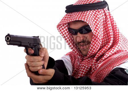 Man holds gun while wearing a keffiyeh
