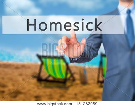 Homesick - Businessman Hand Pressing Button On Touch Screen Interface.