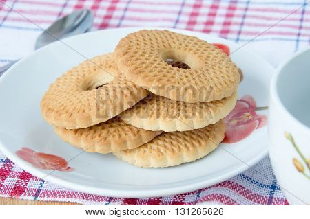 Mountain biscuits on a dish with Apple jam isolated
