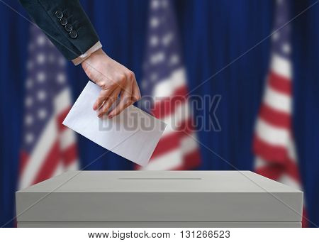 Election In United States Of America. Voter Holds Envelope In Ha
