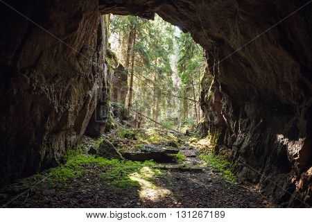 Exit To Forest From The Dark Rocky Cave