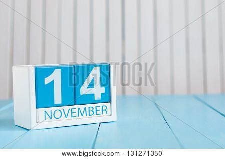 November 14th. Image of november 14 wooden color calendar on blue background. Autumn day. Empty space for text.
