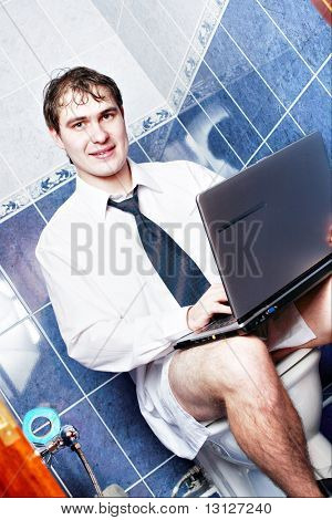 Young stylish man home with laptop