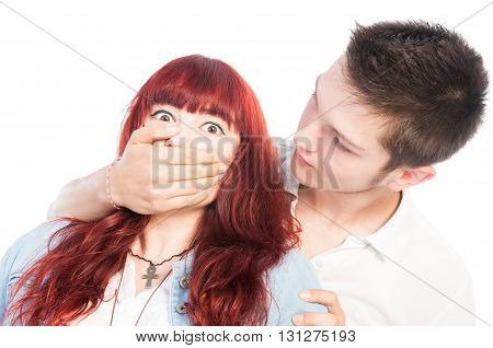 Bullying boy covering the mouth of a bullied girl on white background