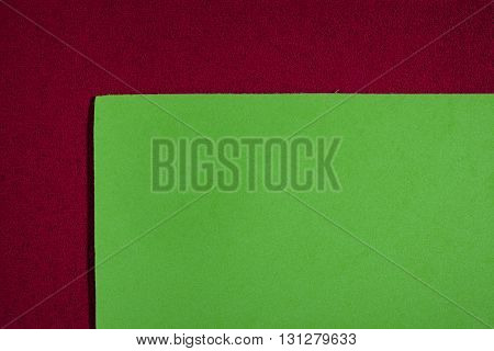 Eva foam ethylene vinyl acetate smooth apple green surface on red sponge plush background
