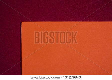 Eva foam ethylene vinyl acetate smooth orange surface on red sponge plush background