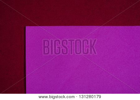Eva foam ethylene vinyl acetate smooth pink surface on red sponge plush background