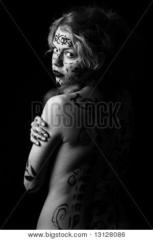 Art shot of a pretty model with bodypainting.